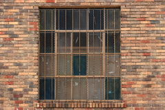 Red brick facade barred window Royalty Free Stock Image