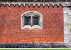 Red brick facade with stone window Royalty Free Stock Photos