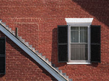 Red Brick Federal House Detail with One Window and Another Bricked Up Stock Photo