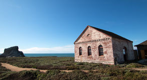 Red Brick Fog Signal Building at the Piedras Blancas Lighthouse on the Central California Coast Stock Photo