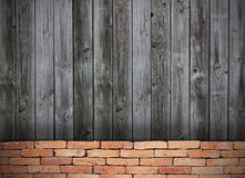 Red brick grunge wall and wooden wall Royalty Free Stock Image
