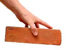 Red brick in hand royalty free stock photo