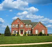 Red Brick Home On The Hill. Red Brick 2-Story Home On The Hill in Summer Stock Images