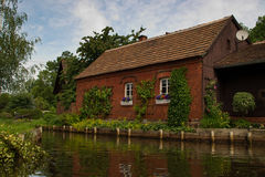 Red brick home in the Spreewald. This red brick home is on a river in the Spreewald Royalty Free Stock Photography