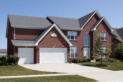 Red brick home with three car garage Royalty Free Stock Image