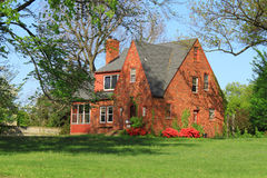 Tradition American House. Historical red brick Tradition American House with green lawn in woods Stock Photography