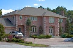 Red brick house. Luxury 5 bedroom 3 bathroom house Stock Images