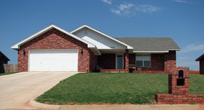 Red brick house. New house on a hill Royalty Free Stock Photography