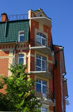 Red brick house balconies Royalty Free Stock Photos