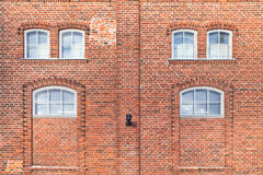 Red brick house facade background texture Stock Images