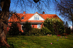 Red brick house and garden royalty free stock photo