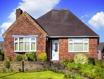 Red brick house with garden Stock Photography