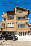 Red brick house in Pomorie, Bulgaria Royalty Free Stock Image