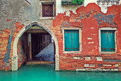 Red brick house and small canal in Venice, Italy. Royalty Free Stock Image