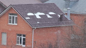 Red brick house in snowfall. Snowfall at background village houses red brick in winter season stock video