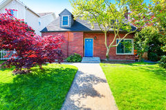 Free Red Brick House With Tile Roof And Maple Tree In The Front Yard Royalty Free Stock Photos - 75952368