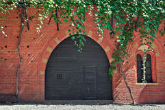 Red brick house with wooden door in Italy. Royalty Free Stock Photos