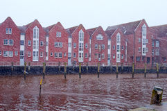 Red brick houses on a riverside. North Sea, Husum, Germany Royalty Free Stock Photography