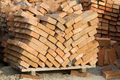 Red brick. Red brick laid on pallets at the construction site Stock Photo