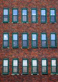 Red brick office building. Exterior of urban red brick office building with windows stock image
