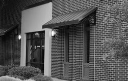 Brick facade with awnings modern building black and white royalty free stock photos