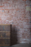 Red brick. Old wooden suitcase and dilapidated wall of red brick Stock Image