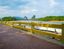 Red brick path way with scenic waterfront mountain view in Krabi, Thailand. royalty free stock images