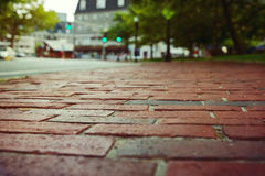 Red brick pavement in Boston, Massachusetts, USA. Selective focus. Red brick blur pavement in Boston, Massachusetts, USA. Selective focus royalty free stock images