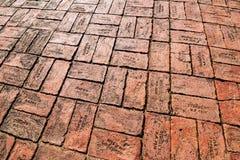 Red brick paving on a sidewalk at Ayutthaya.Thailand. Stock Photos