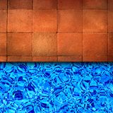Red brick pool edge Stock Photo