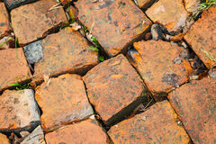 Red brick road macro fragment, background texture Royalty Free Stock Photos