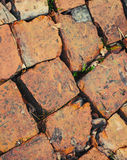 Red brick road macro fragment, photo background Royalty Free Stock Image