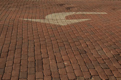 Red brick road with white painted arrow Royalty Free Stock Images