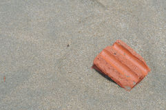 Red brick on sand Royalty Free Stock Photography
