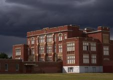 Red Brick School With Dark Storm Clouds