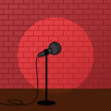 Red brick spotlight stand up comedy stage. Art Royalty Free Stock Images