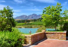 Red brick square, pond and blueish misty mountains Stock Photography
