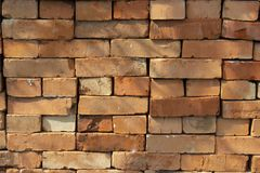 Red brick stack, background texture pattern. A pile of bricks material for construction. Red sandstone silicate brick royalty free stock photos