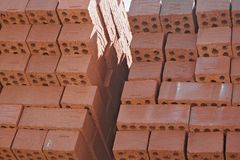 Red brick in stacks at the factory royalty free stock images