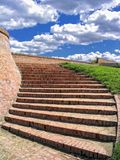 Red brick stairway with cloudy sky. On the top Stock Photo