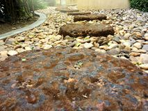 Red brick stone footpath step low angle view on small rock in the garden. royalty free stock images