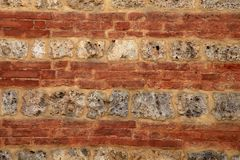 Brick and stone medieval wall textured background stock photos