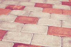 Red brick stone street road. Light sidewalk Royalty Free Stock Images