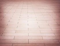 Red brick stone street road. Light sidewalk Royalty Free Stock Photography