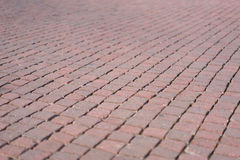 Red brick tile pavement, floor background, with depth of field effect Royalty Free Stock Photography