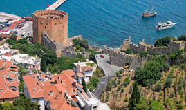Red brick tower in port of Alanya Royalty Free Stock Photos