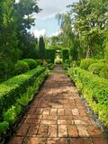 Red brick walking path in Englidh Garden Royalty Free Stock Images