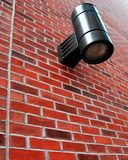 Red brick wall. With a street light attached Stock Images