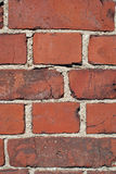 Red Brick Wall. A detail of red brick wall, vertical view, suitable for background Royalty Free Stock Images