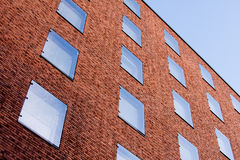 Red brick wall. Exterior wall of a modern residential building Stock Photography